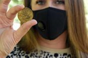 Chelsea McGill displays recovery coin