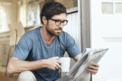 Man drinking coffee and enjoying the newspaper