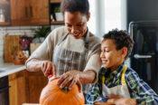 Woman carving pumpkin